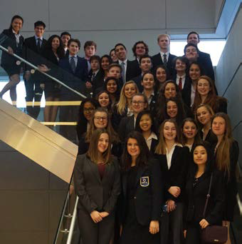 DECA Students stand on a stairwell for a group picture